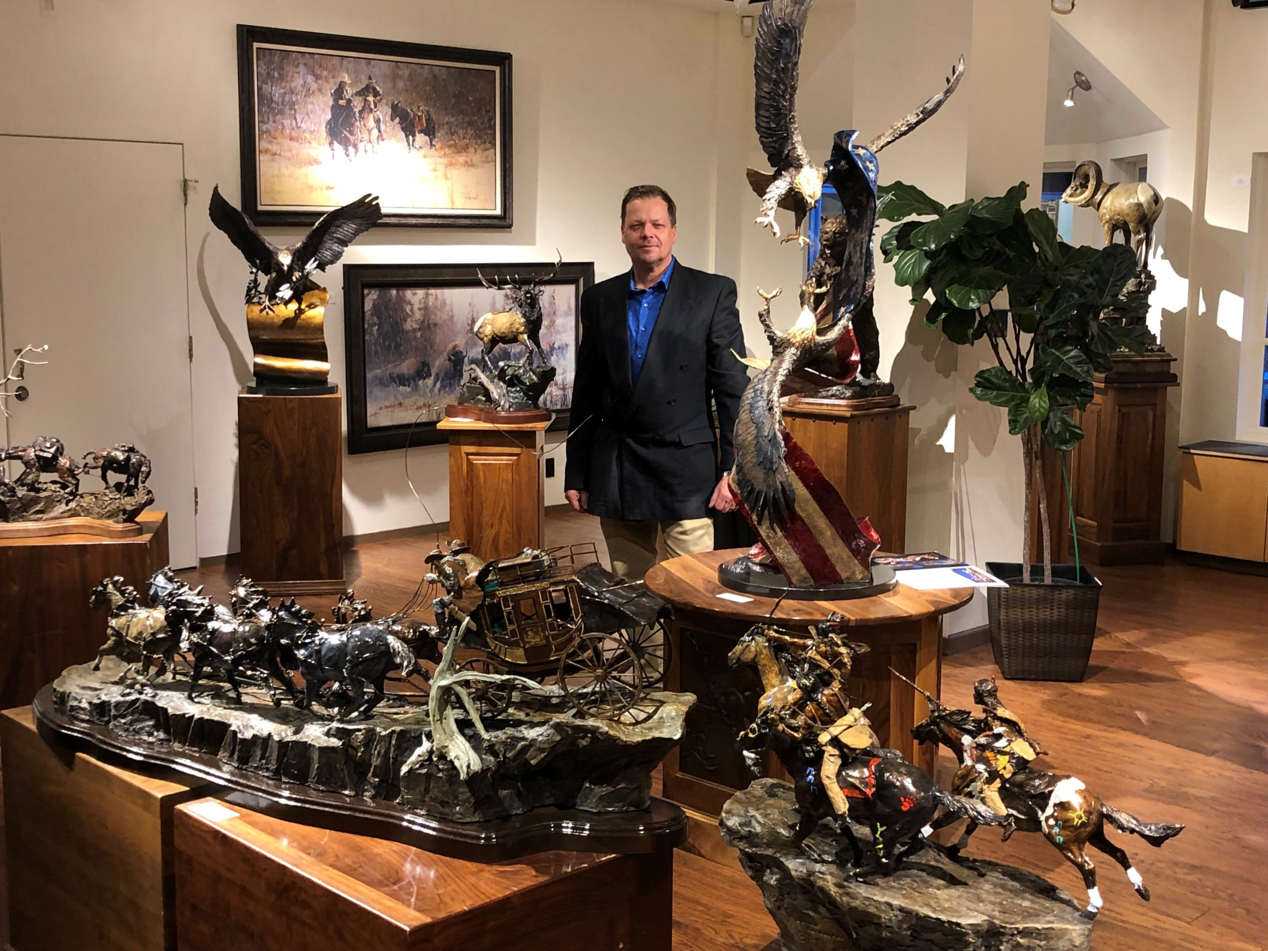 laran ghiglieri at c anthony gallery in beaver creek colorado surrounded by his famous bronze sculptures