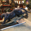 Rough profile photo of Dark Ferocity (black jaguar) at the Treasure Investments Corp HQ on the floor before shipping out