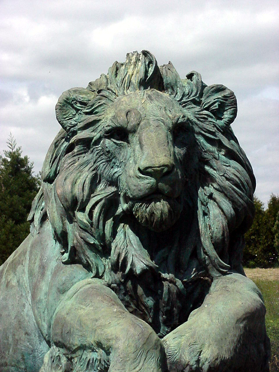 heroic lion front view with aged bronze classic patina